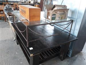Large wooden table and smaller glass top table