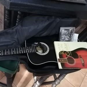 Acoustic guitar with extras