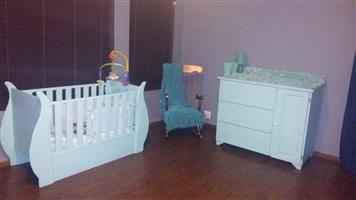 Wood sleigh cot with chest of drawers