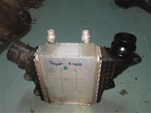 JAGUAR INTER-COOLER FOR SALE VIA MONNYMAX INVESTMENT AUTO SPARES PTY NO 29 BETTY STREET JEPPES TOWN JOHANNESBURG