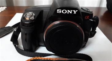 Sony 290A DSLR camera with 5 lenses and  flashlight in very good condition.