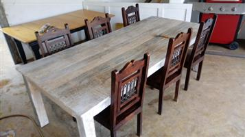 Large hardwood table and 6 x hardwood chairs with wrought iron inlays