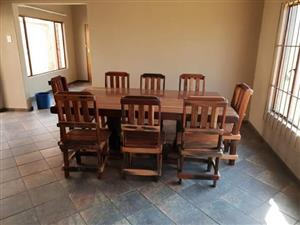 Dining-room table & 8 chairs made from sleepers