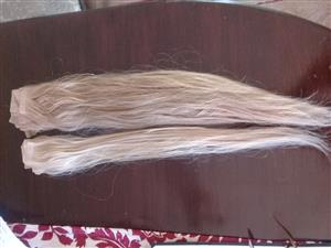 100% real human hair.  Hair extensions