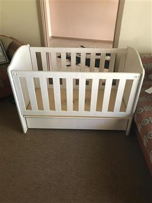 Adjustable cot with bottom drawer