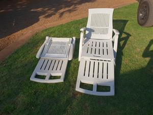 2 White pool loungers for sale