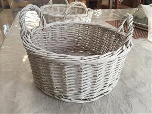 Pair of distressed white wicker baskets with removable cotton lining