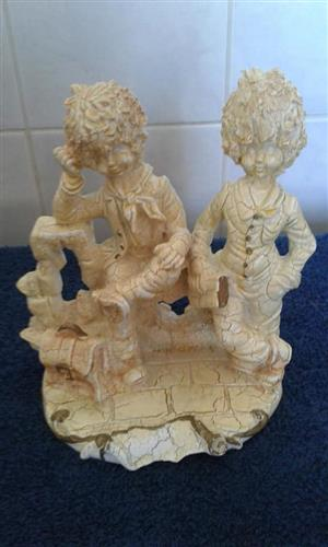 Two boys statues for sale