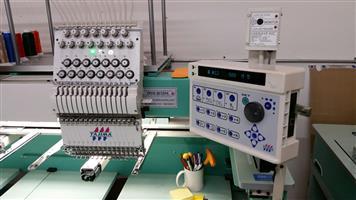 Tajima Stretch (450 x 500) 4 head 15 needle embroidery machine for sale.