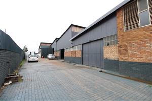 4,981 m² Industrial Property FOR SALE - with several workshops, storerooms, a modern flat and so much more.