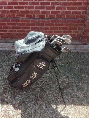 Grand Slam PENGUIN Golf bag and Golf Sticks and equipment.