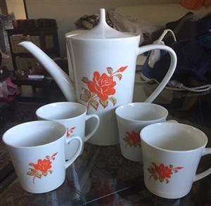 Beautiful tea cups and matching tea pot