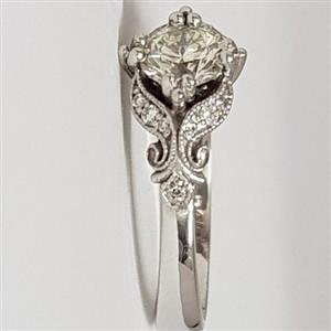 Antique style white gold ring with half carat yellow diamond
