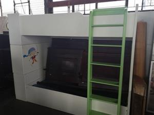 White bunkbed with green ladder