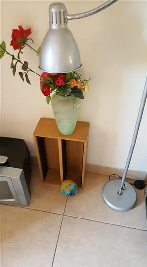 Glass vase with fake flowers