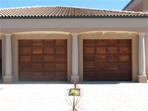 Single and double meranti garage doors in Fourways