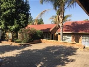 Property, plot with 4 units and a car workshop for sale