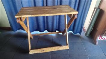 Wooden folding table for sale.
