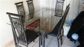 Steel and Glass 6 seater Dinning room set.