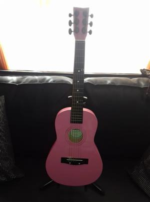 Pink starter guitar with stand