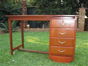 Wooden desk with four drawers