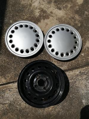 One 13 inch caravan spare rim and two Hubcaps in good condition