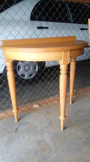 Wooden halfmoon table