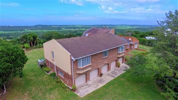 Stunning 5 bedroom home with 2 bedroom flat on a secure smallholding