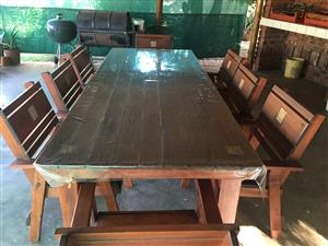 Large golden brown patio set, 8 seater for sale. Includes 8 chair cusions