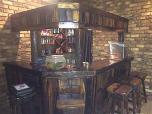 Sleeper wood bar, 7 bar stools and shelf for sale
