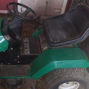 Two sit on lawnmowers