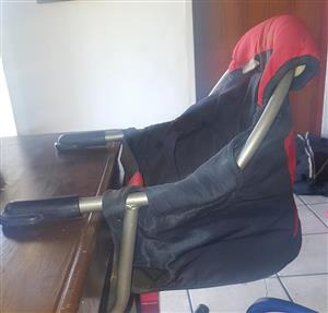 Black and red clip on chair for sale
