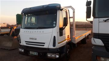 Iveco 100E17 with flat deck body