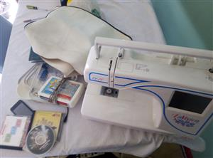 Embroidery machine for sale Elna with accessories including manual and digitizing software R8000 for the whole package