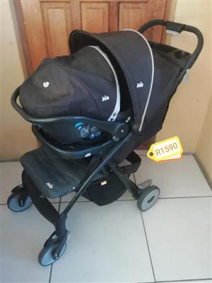 Dark blue Joie pram and carrier