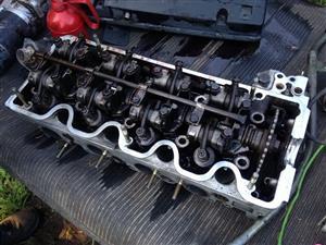 Mercedes-Benz M102 230e cylinder head.