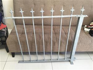 Galvanised metal fence/lane gate with spear-detail top spikes