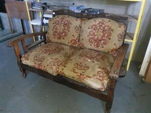 2 Seater wooden couch with pillows