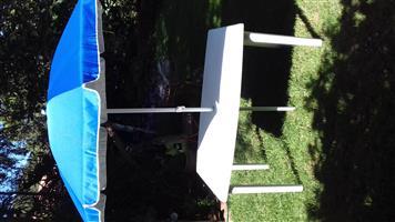 White Plastic Table with Sun Umbrella.
