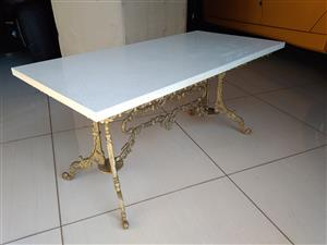 Brass coffee table with Ceasarstone top