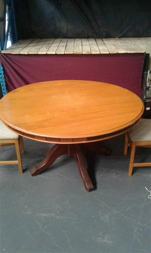 Yellow wood dinning room table for sale.
