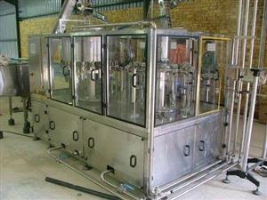 Water Bottle Filling Line: Rinser filler capper with auto shrink sleeve labeller