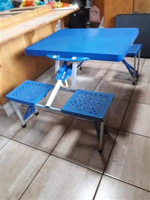 Blue fold up kiddies table and benches