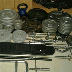 a lot of weights and bars ect