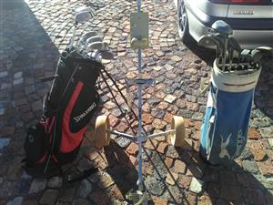 Two golf sets and a trolley