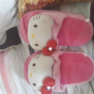pair of hello kitty slippers