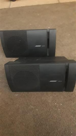 2 Bose speakers.  Compatible with amplifiers and receivers.  Perfect working order.