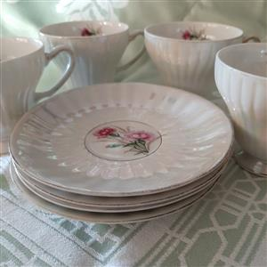 8 piece vintage mother-of-pearl tea cups and saucers