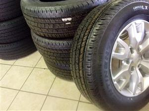 18 inch silver Ford wildtrack rims with 265/60/18 Continental cross contact R9250 set.