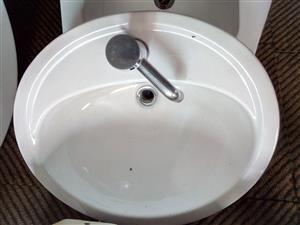 Basins with taps